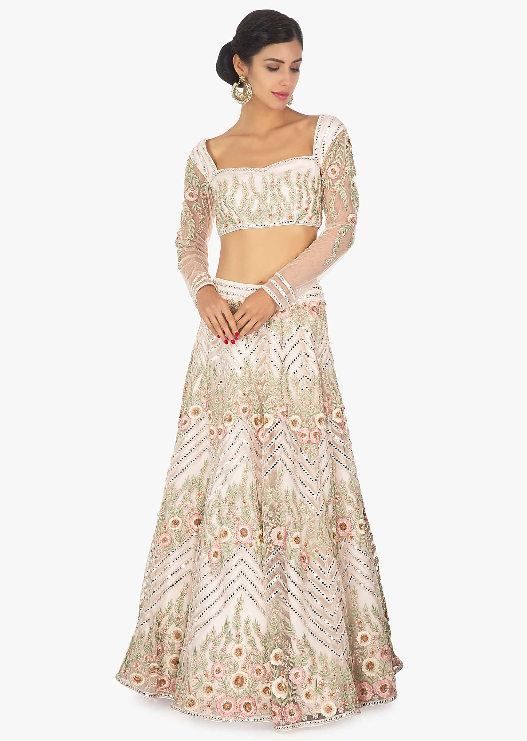 9add4ee95d Off white embellished satin net lehenga and blouse paired with a light  green net dupatta only on Kalki More Detail