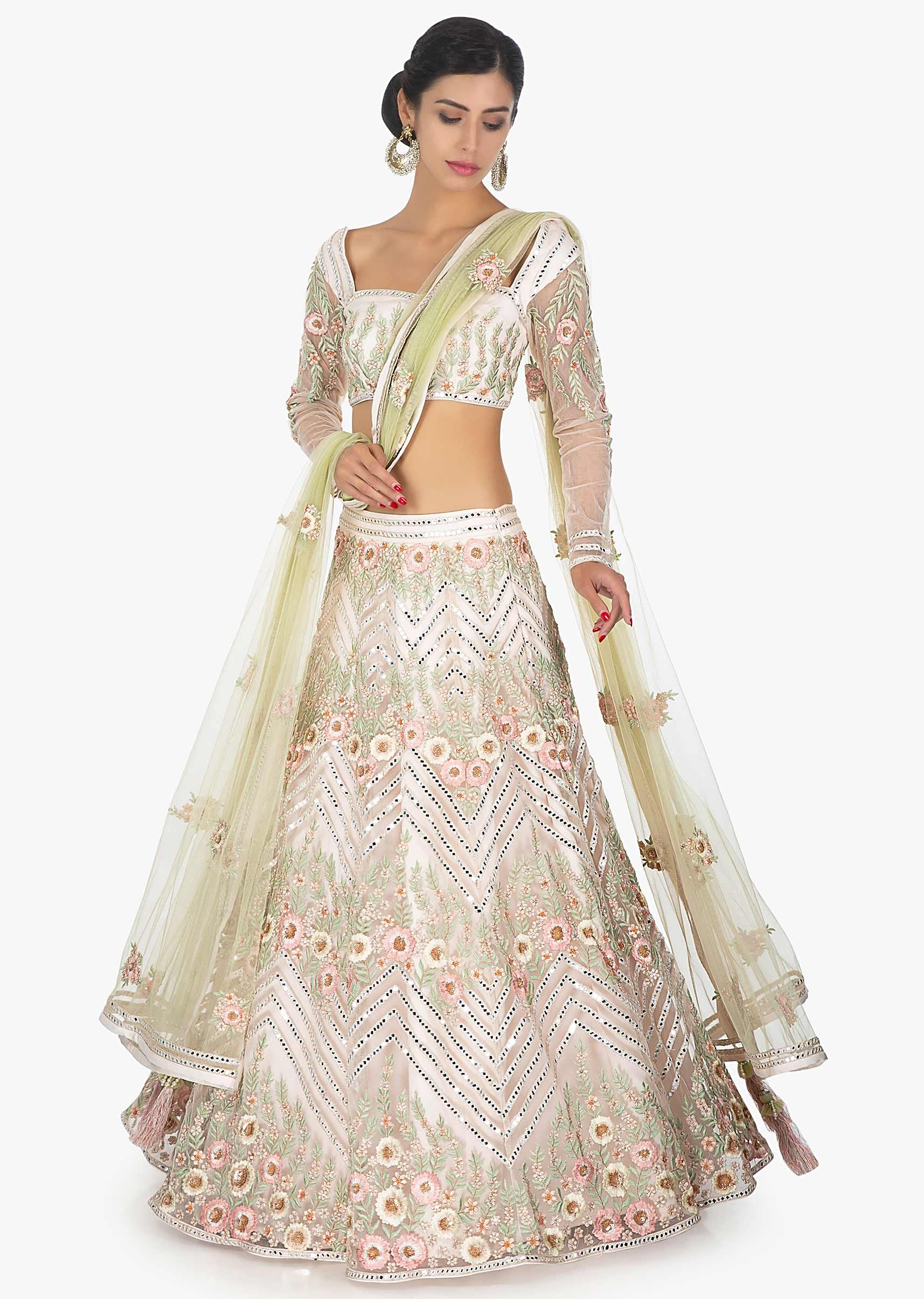 0ccc780f5eba6a Off white embellished satin net lehenga and blouse paired with a light green  net dupatta only on Kalki More Detail