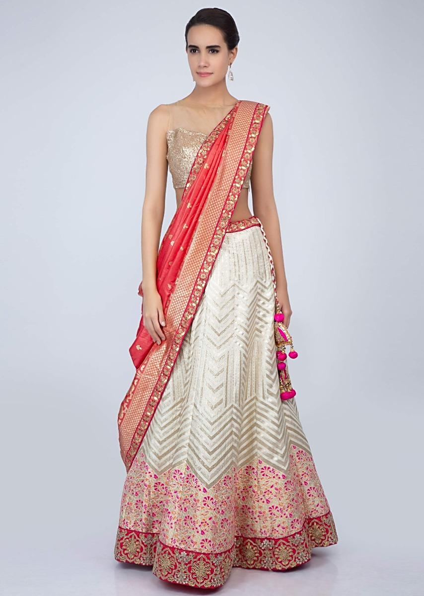 2b72c34d4 Off white floral embroidered brocade silk lehenga with contrasting peach  dupatta only on Kalki