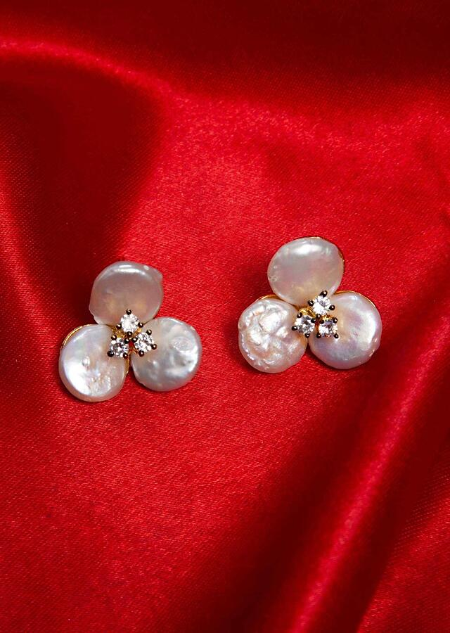 Off white floral stud adorn with mother of pearls and stone  only on Kalki