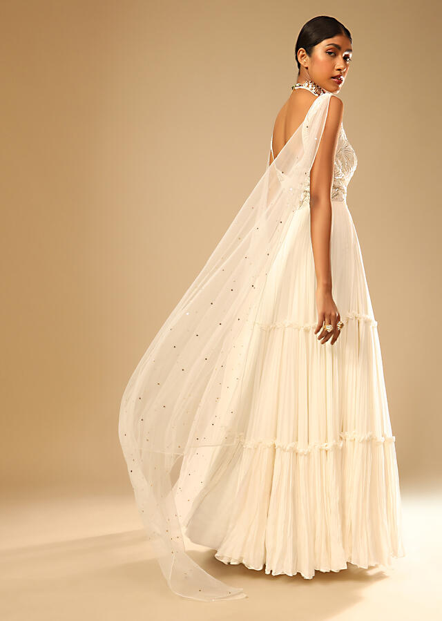 Off White Gown In Georgette With Tiered Flare And Hand Embroidered Leaf Motifs On The Bodice Online - Kalki Fashion