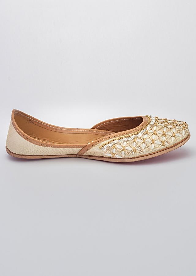 Off White Juttis In Banarasi With Raffia And Zardozi Work In Checks Pattern Along With Beads By Vareli Bafna