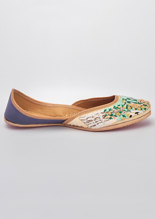 Off White Juttis In Linen With Multicolour Fine Thread Work Along With Dori And French Knots By Vareli Bafna