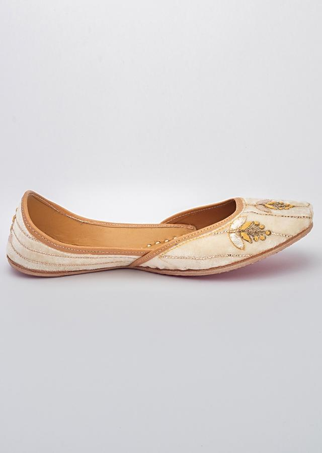 Off White Juttis In Velvet With Thread, Zardozi And Gotta Patch Embroidered Floral Pattern By Vareli Bafna
