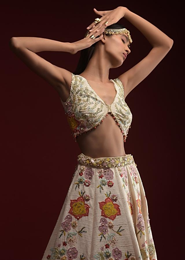Off White Lehenga Choli In Raw Silk With Colorful Resham Embroidered Floral Motifs Along With Sequins And Moti Accents Online - Kalki Fashion