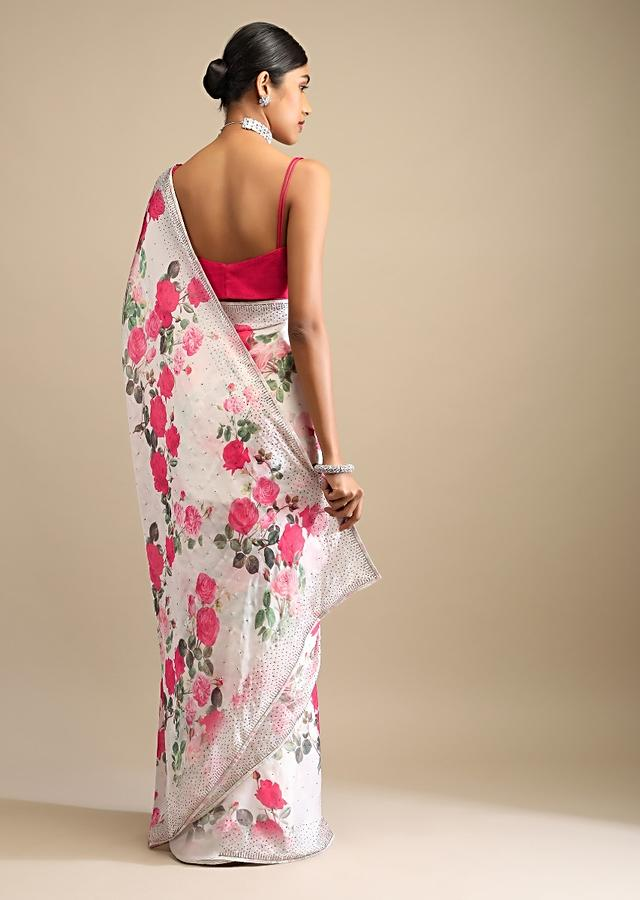 Off White Saree In Crepe With Floral Print All Over And Multi Colored Kundan Accents Along The Border Online - Kalki Fashion