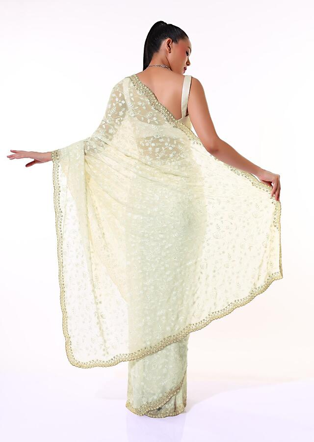 Off White Saree In Georgette With Lucknowi Thread Embroidered Floral Jaal And Golden Border Accents Online - Kalki Fashion