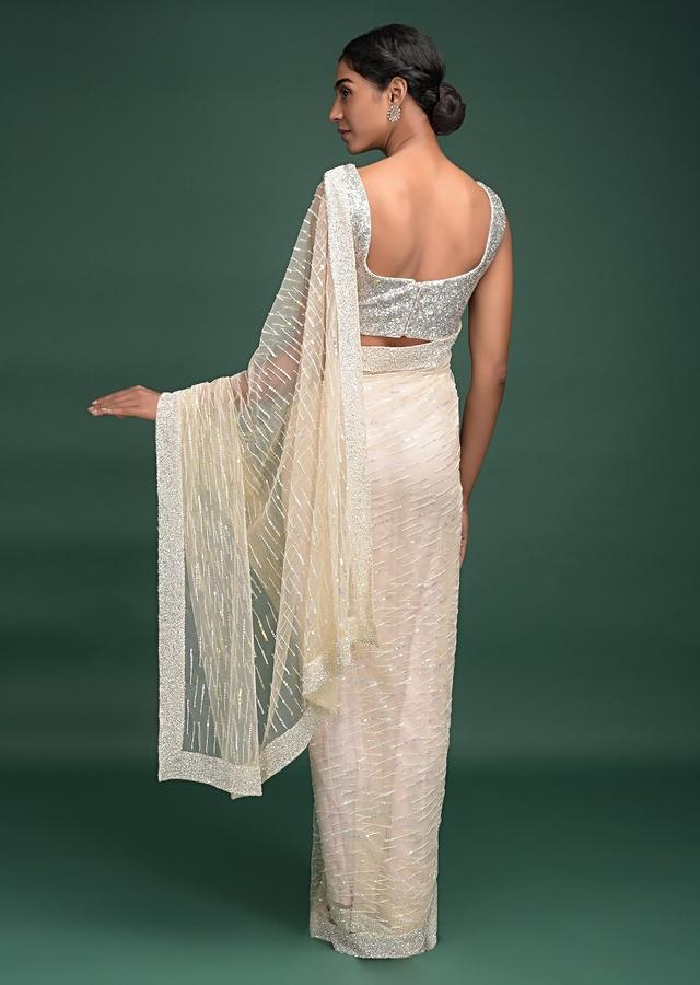 Off White Saree In Net With Pink Thread, Beads And Sequins Work Striped Pattern Online - Kalki Fashion