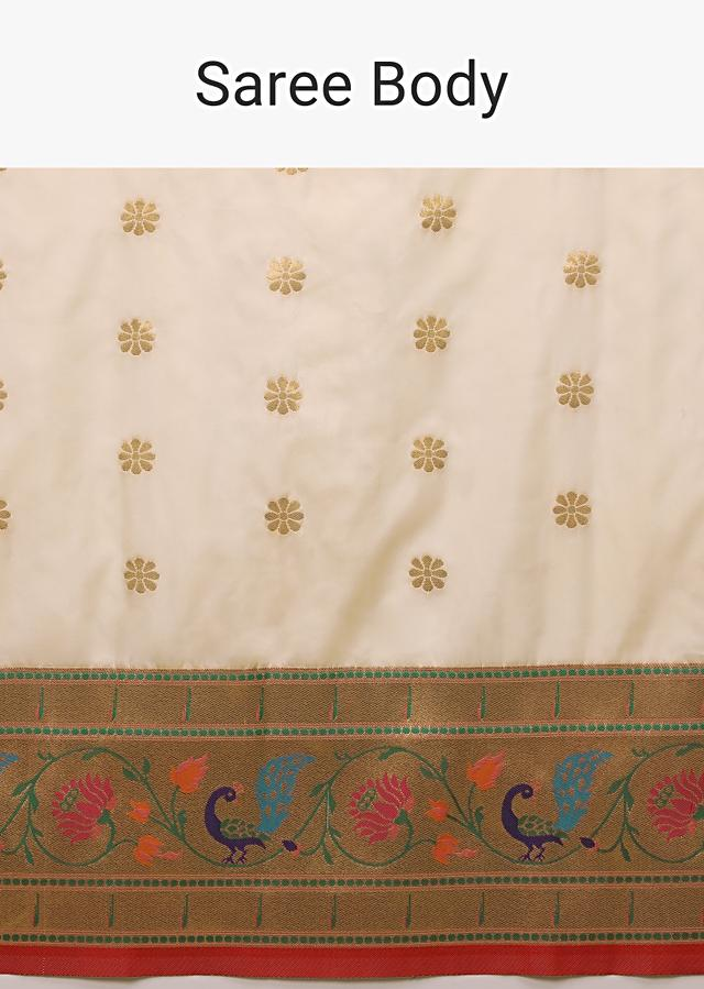 Off White Saree In Pure Handloom Silk With Woven Multi Colored Peacock Motifs On The Border, Floral Buttis And Unstitched Blouse Online - Kalki Fashion