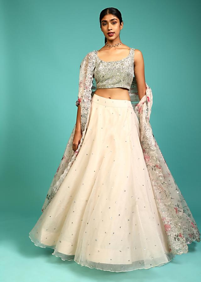 Off White Skirt In Organza With Sequin Embellished Buttis And Heavy Embroidery On The Crop Top Along With Floral Printed Dupatta Online - Kalki Fashion