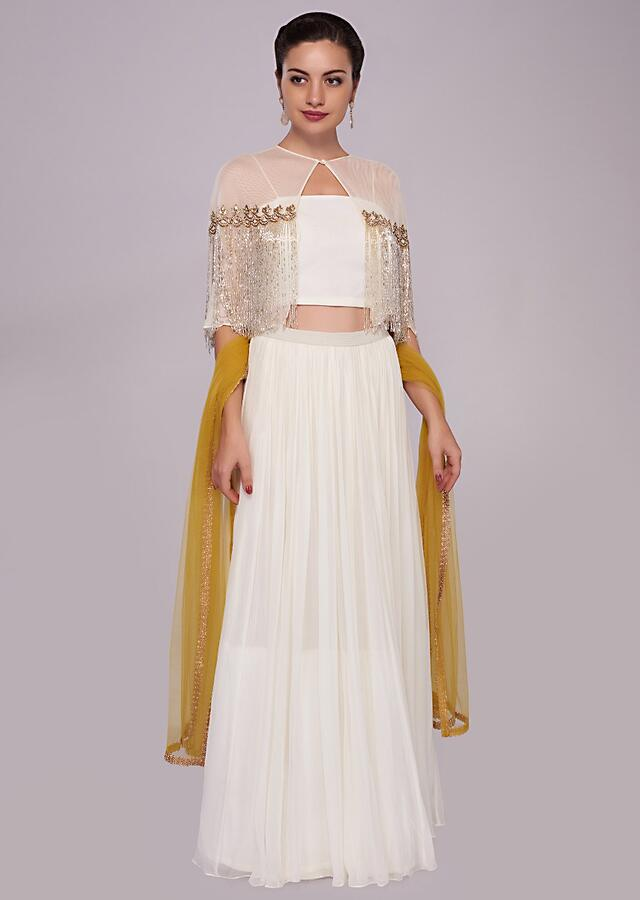 White Skirt In Georgette With Crop Top Blouse And Tassel Embroidered Cape Online - Kalki Fashion