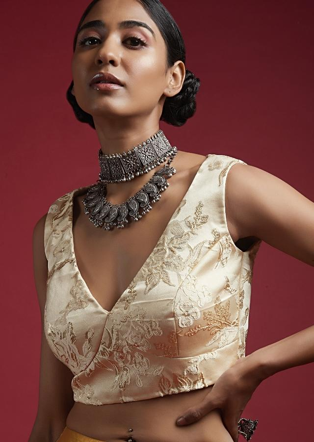 Off White Sleeveless Blouse In Brocade Silk With Woven Floral Design And V Neckline Online - Kalki Fashion