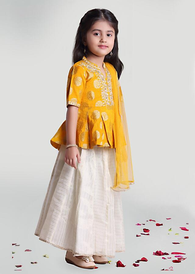 Off White Striped Skirt And Yellow Peplum Choli In Brocade With Woven Buttis And Embroidery Design By Mini Chic