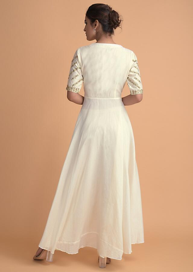 Off White Suit With High Low Hem And Front Slit Paired With Cigarette Pants Online - Kalki Fashion