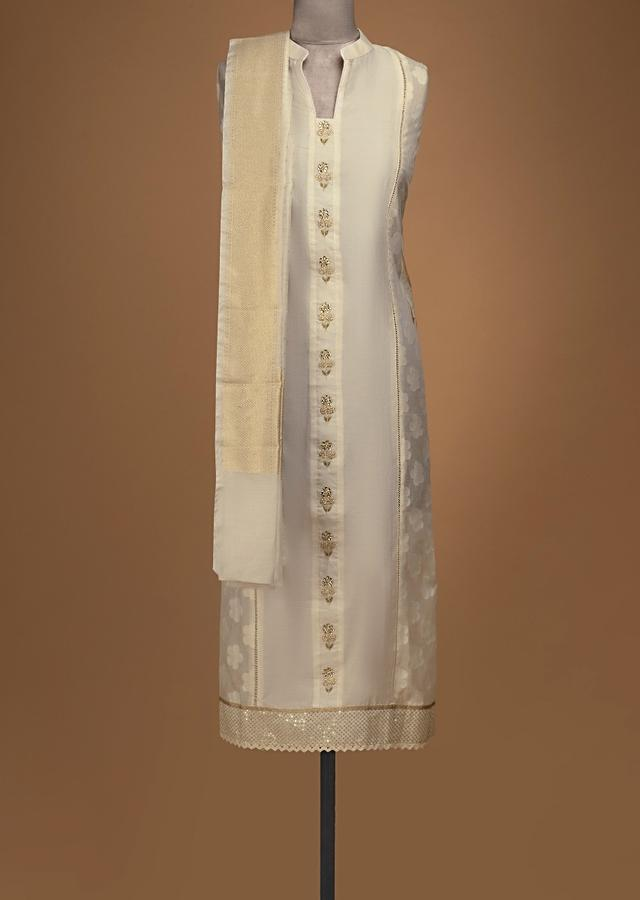 Off White Unstitched Suit In Cotton With Embroidered Buttis And Weaved Design Online - Kalki Fashion