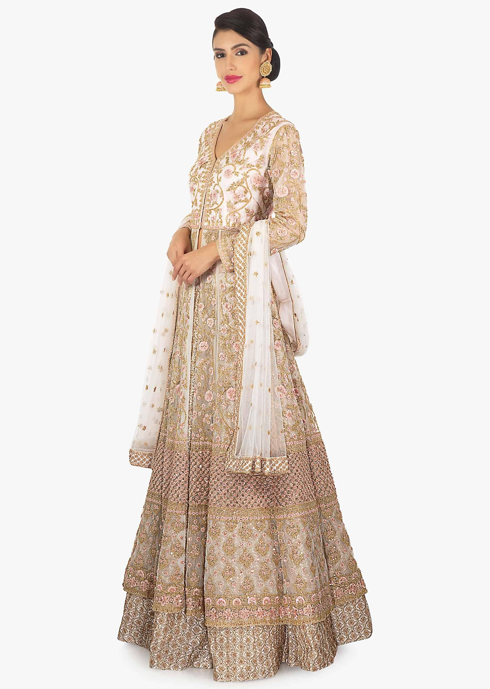 8e2ac65d658a0 Off white zari lehenga paired with a long net embellished jacket only on  Kalki