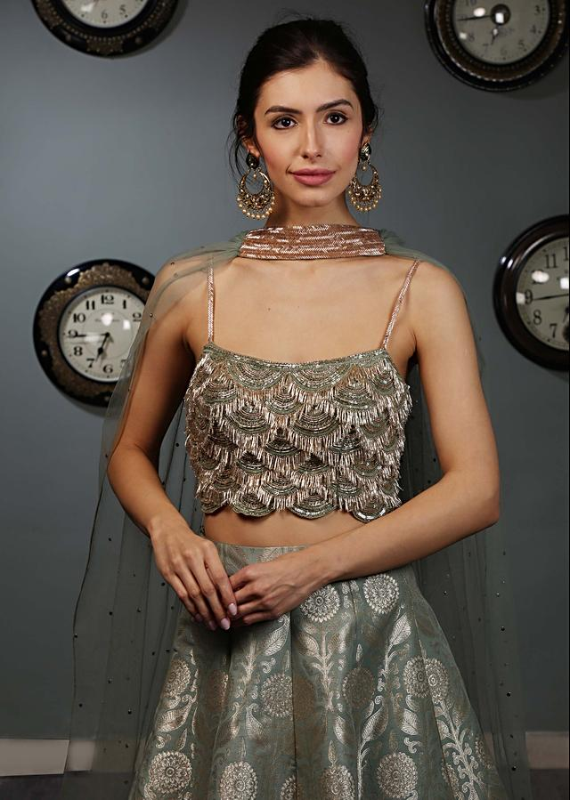 Olive Green Brocade Lehenga With Sequins And Cut Dana Embroidered Blouse And Matching Net Dupatta Online - Kalki Fashion