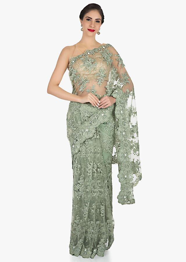 Olive green in embroidered net embellished with resham and moti work only on Kalki