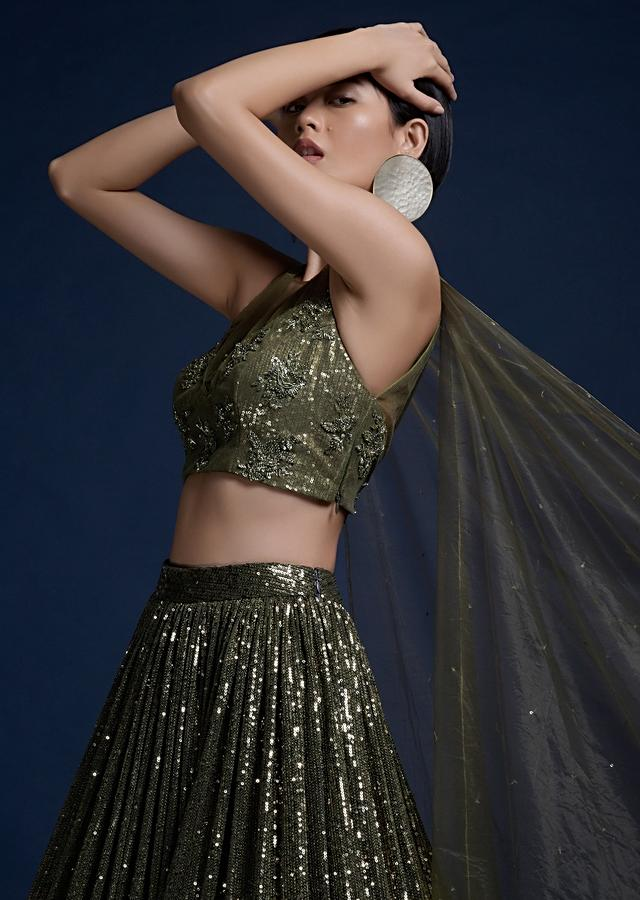 Olive Green Lehenga In Sequins Fabric And Cut Dana Embellished Crop Top With Attached Net Cape Online - Kalki Fashion