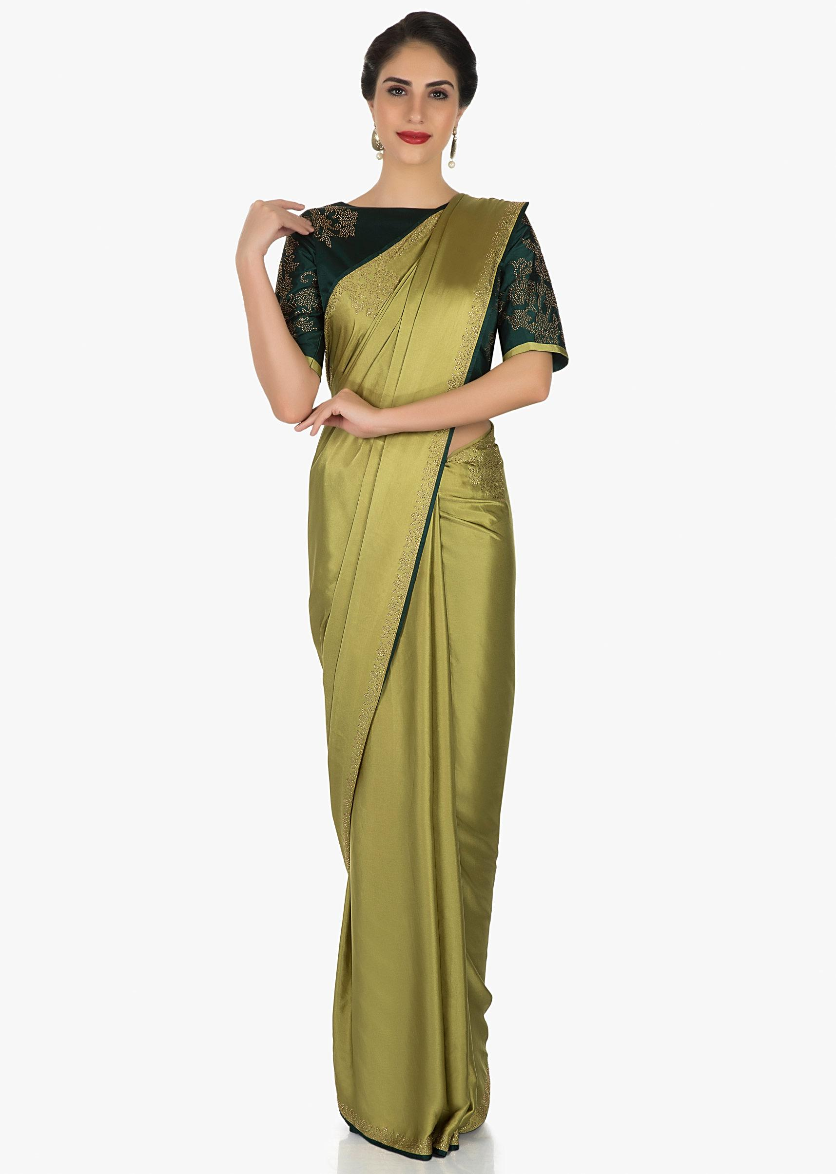 44cc99eaf8c2b Olive green saree beautified with the kundan embroidery only on Kalki