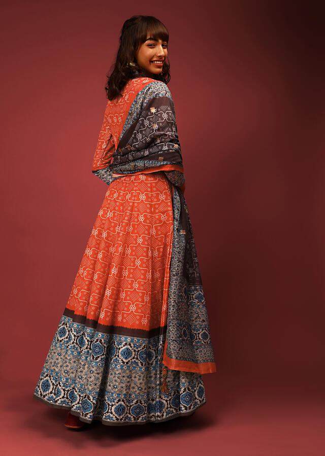 Orange Anarkali Suit In Silk With Bandhani Jaal And Contrasting Grey And Blue Border With Ethnic Print Online - Kalki Fashion