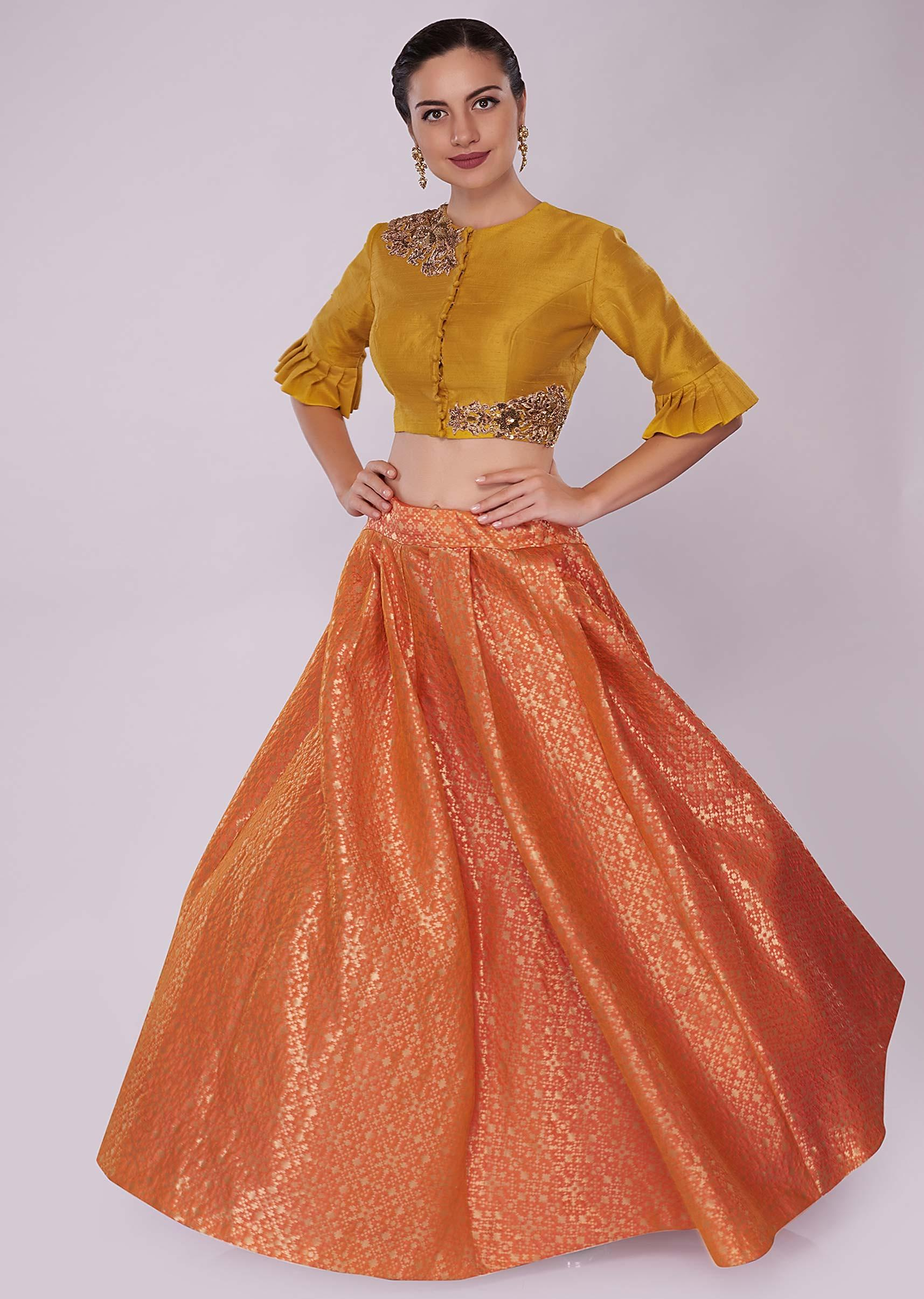 cda3684ad4daf Orange brocade skirt paired with a chrome yellow raw silk crop top only on  Kalki