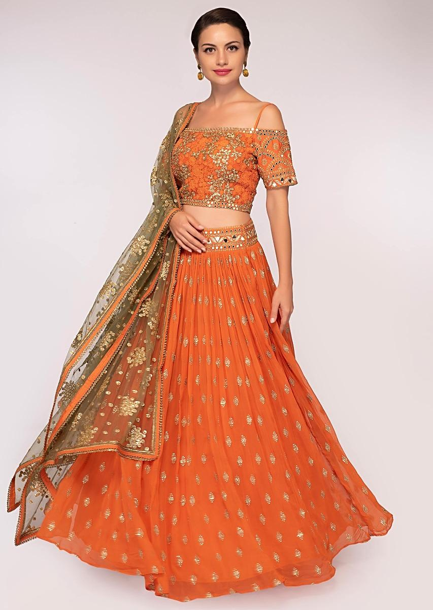 18fbb3033e Orange georgette lehenga set with sequins and zari embroidery and butti only  on Kalki More Detail