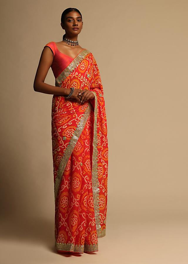 Orange Saree In Georgette With Bandhani Jaal All Over And Gotta Embroidered Border Along With Unstitched Blouse Online - Kalki Fashion