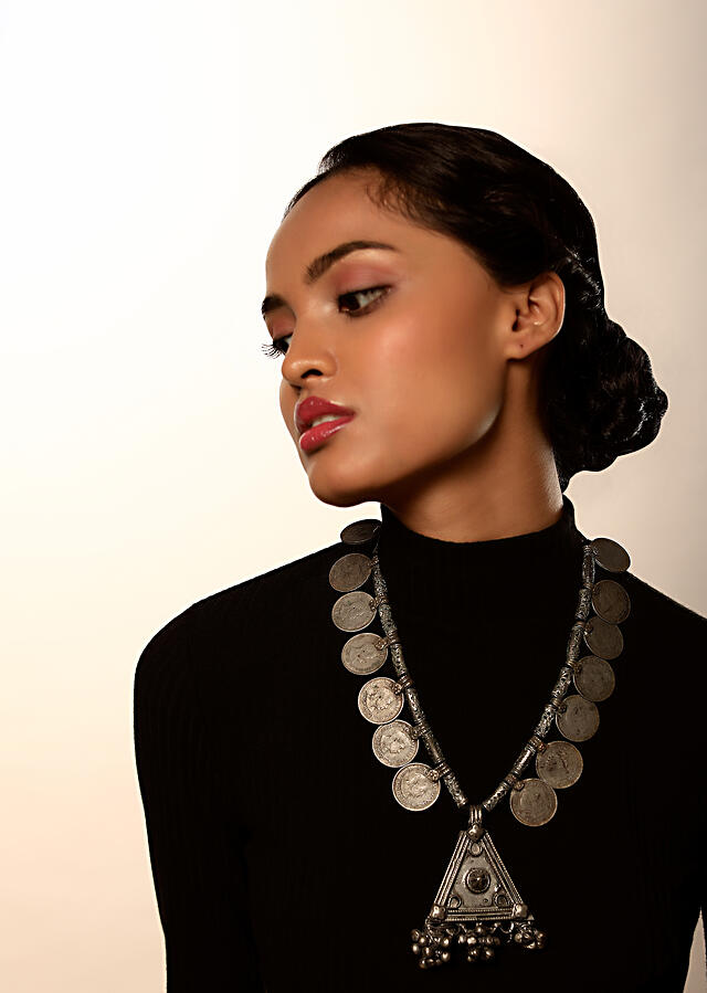 Oxidised Antique Necklace With Coins And Carved Beads Along With A Triangular Pendant Featuring Ghungru Tassels By Kohar
