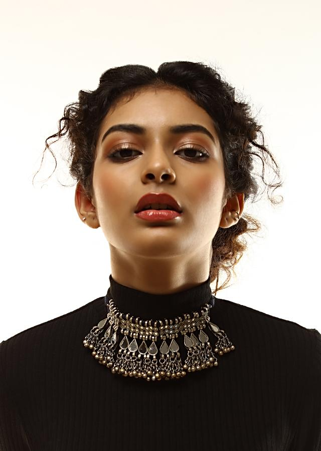Oxidised Necklace With Mirror Work In Round And Drop Motifs Along With Ghungru Tassels By Kohar