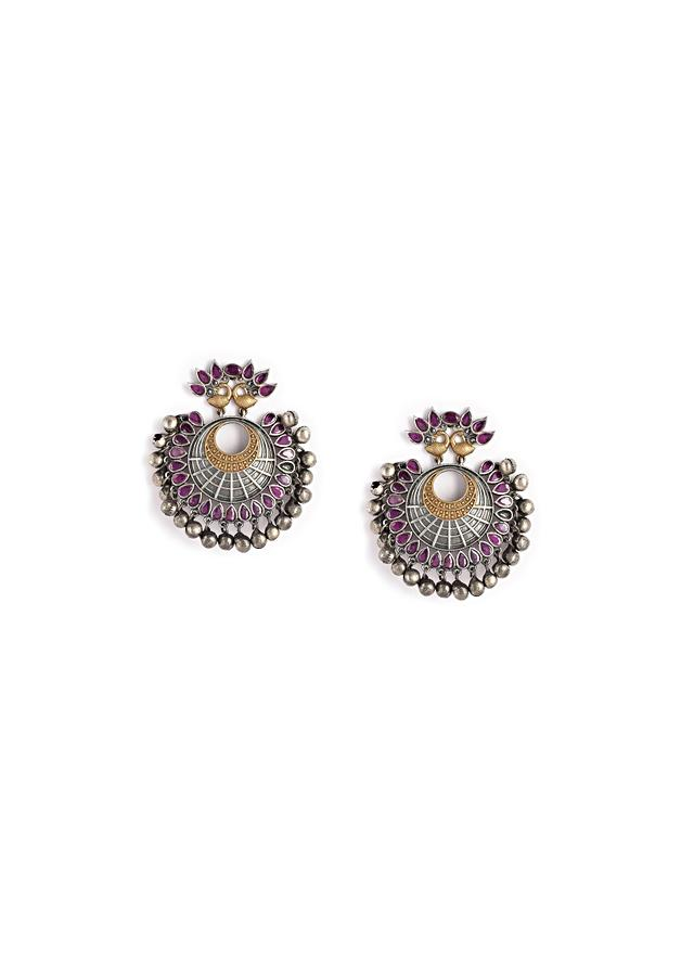 Oxydised Danglers With Carved Peacock Motif Along With Magenta Semi Precious Stones And Ghungru Tassels By Kohar