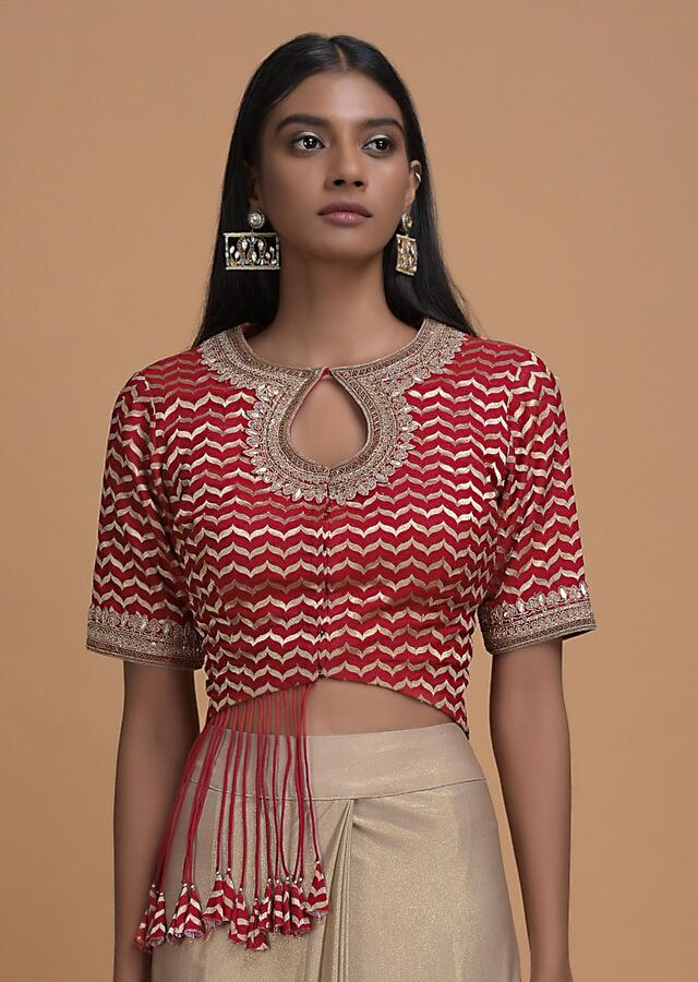 Pale Gold Ready Pleated Saree In Shimmer With Fancy Tassel Adorned Red Blouse Online - Kalki Fashion