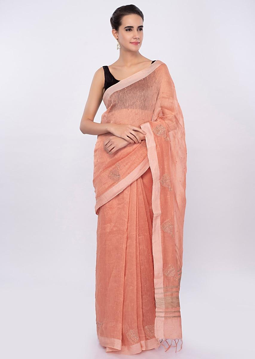 dda57ca1d5b89 Pale orange linen saree with self moti embroidery and butti only on Kalki