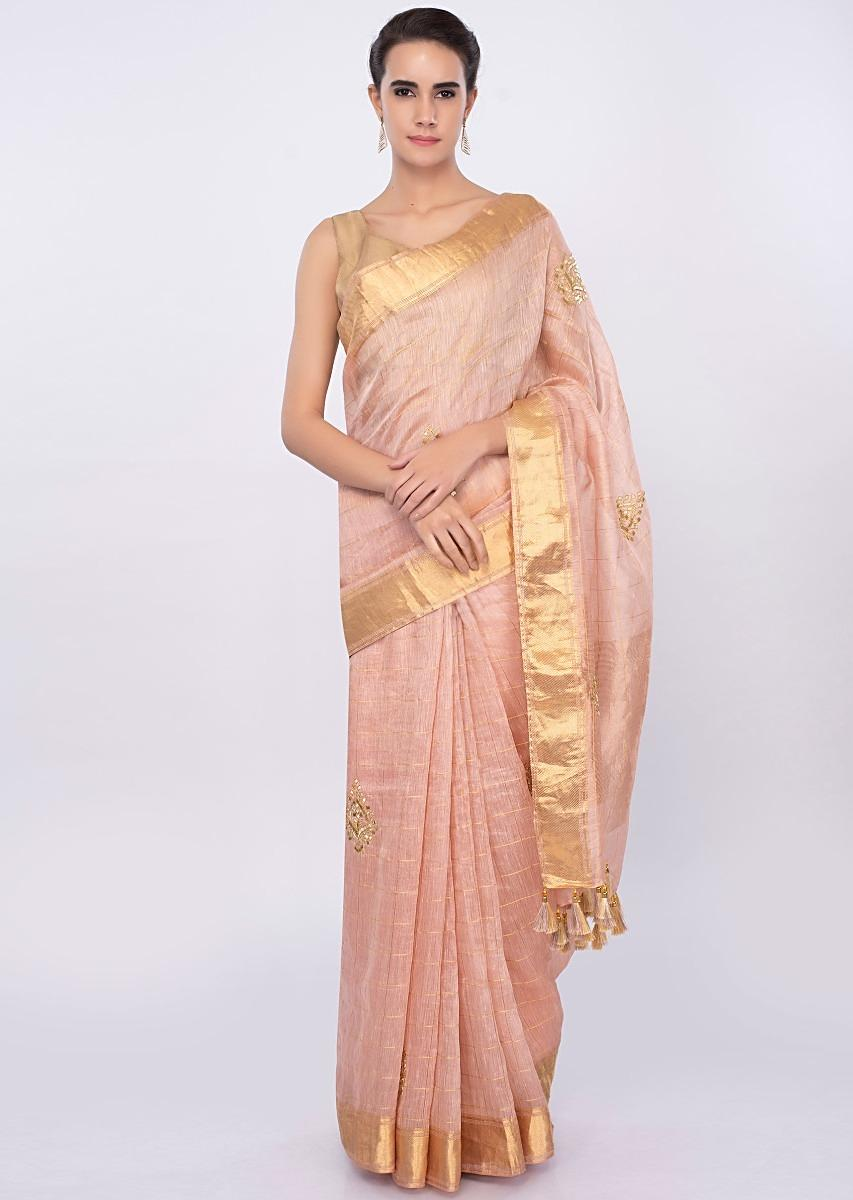 f3d2d247ceac4 Pale peach linen saree with cut dana and zari butti only on Kalki