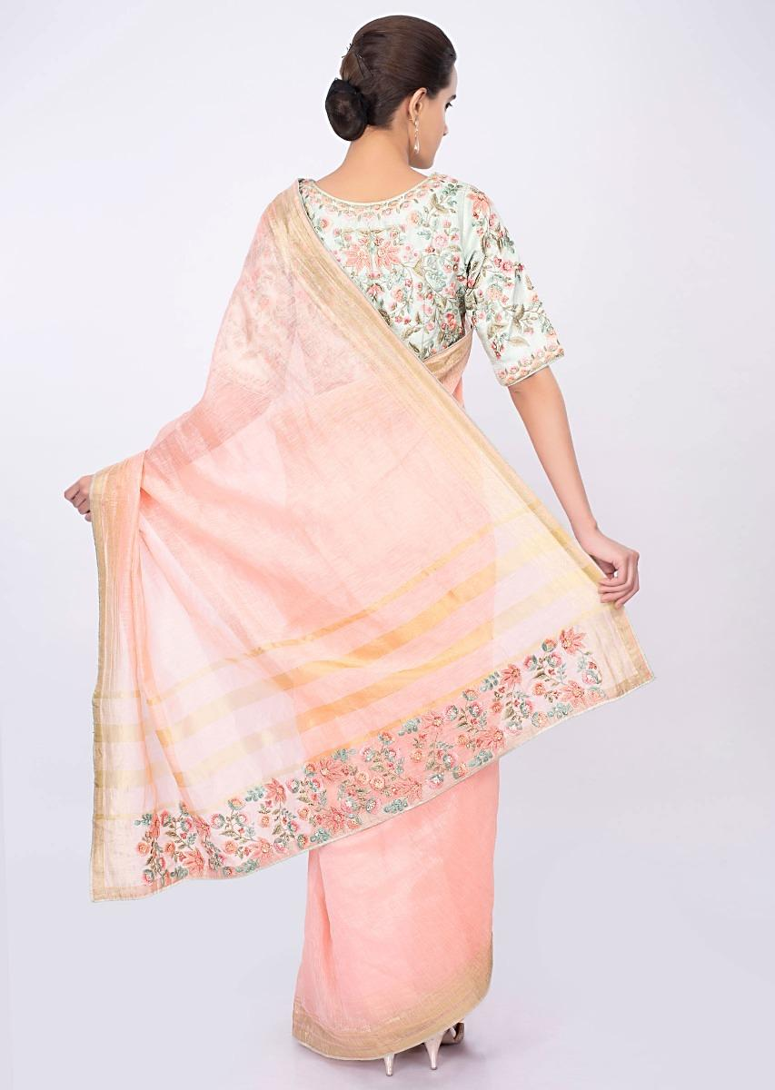 b2b459c88e088 Pale pink linen saree with mint green floral embroidered blouse only on  kalki