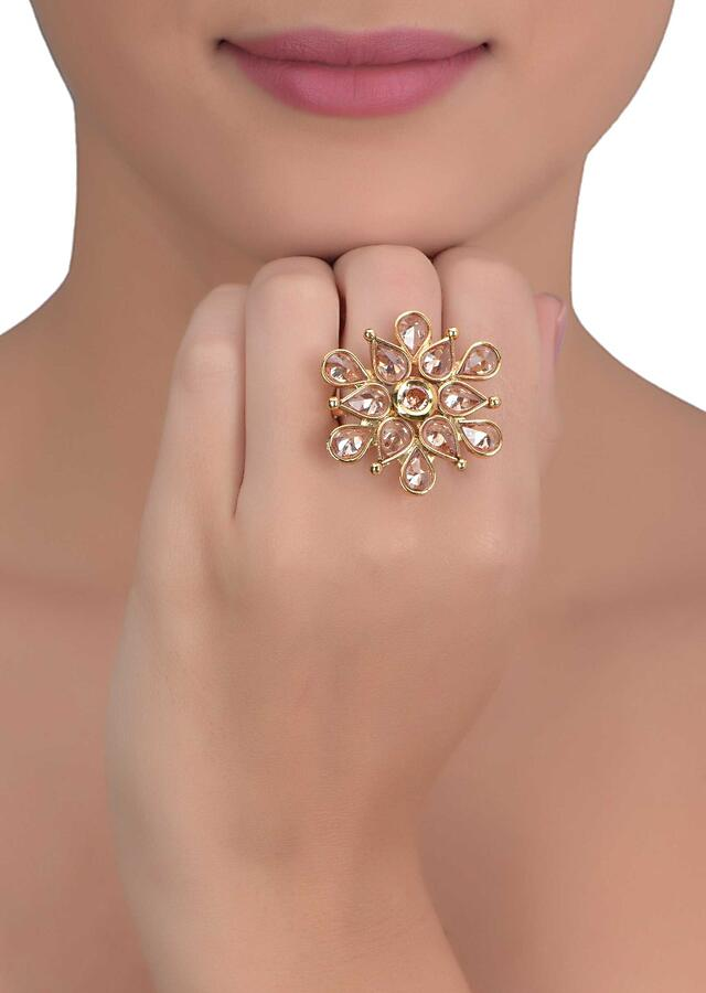 Gold plated floral pattern ring with tear drop and round pale wheat crystals only on Kalki