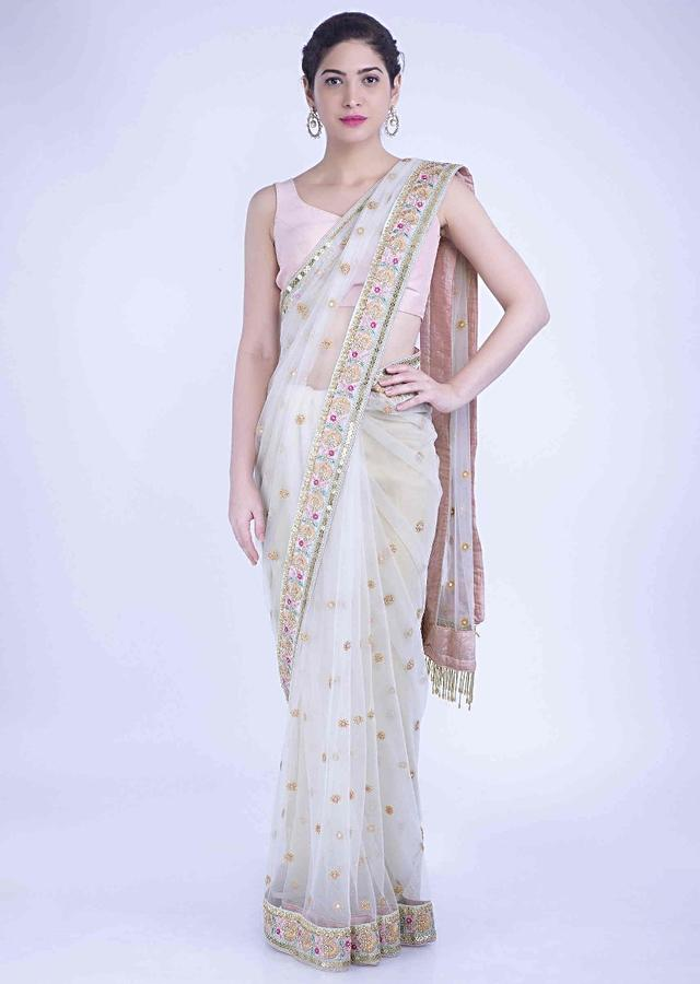 Parchment White Saree In Net With Peach Raw Silk Blouse Piece Online - Kalki Fashion