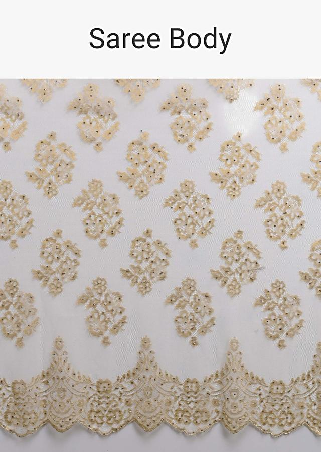 Parchment White Saree In Net With Weaved Golden Floral Motifs And Kundan Work Online - Kalki Fashion