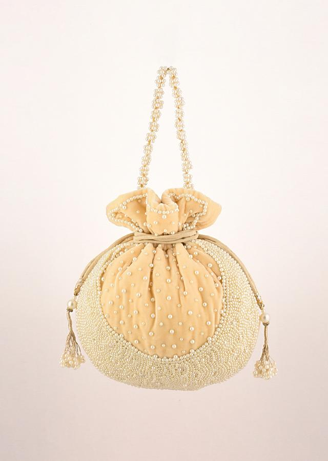 Parmesan Yellow Potli Bag In Velvet With Moti Work In Crescent Design Along The Edge And Scattered In The Centre By Shubham