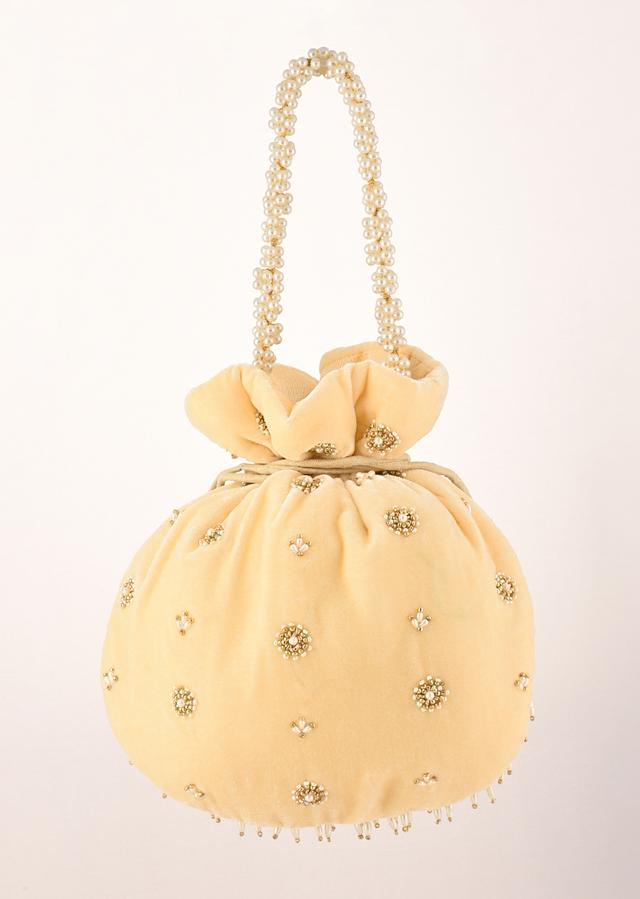 Parmesan Yellow Potli In Velvet Heavily Embroidered With Beads And Moti Work In Scalloped And Tassel Design By Shubham