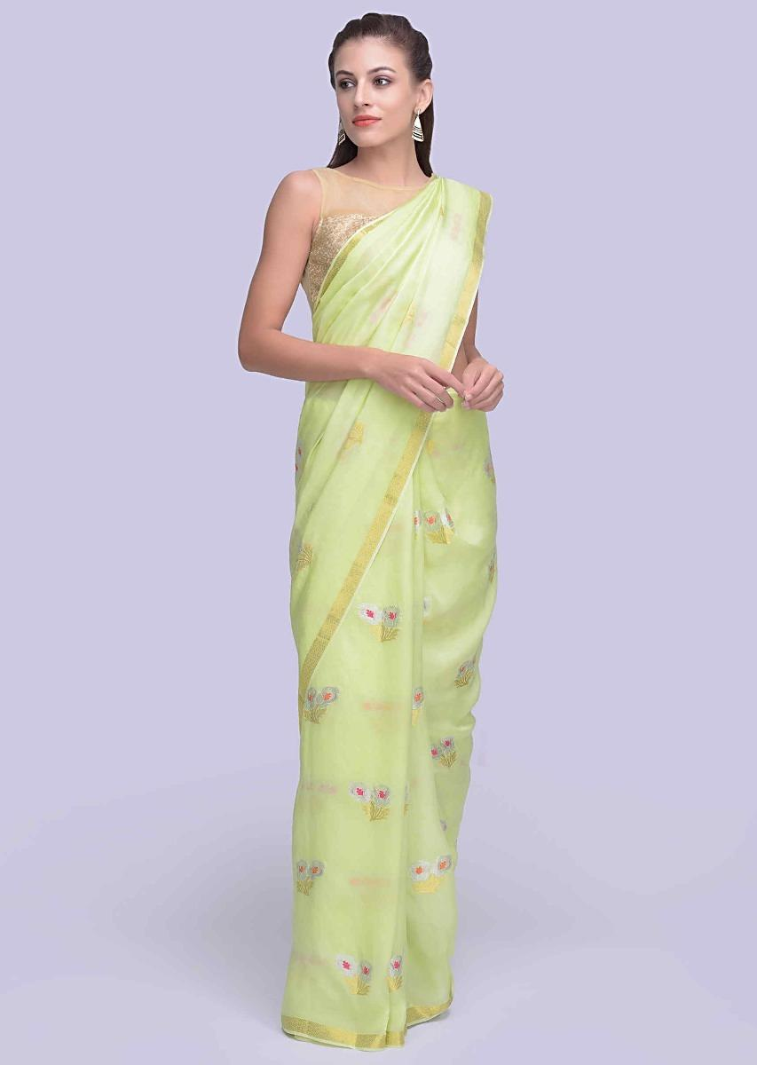 f37073de9e Parrot green dola silk sarees with weaved floral butti only on Kalki