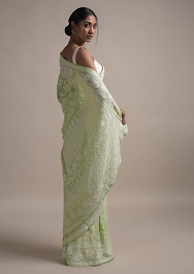 Pastel Green Saree In Georgette Adorned With Lucknowi Thread Embroidered Floral Jaal Online - Kalki Fashion
