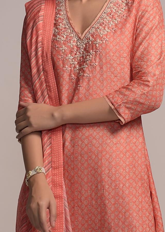 Pastel Orange Straight Cut Suit In Cotton With Printed Buttis And Matte Sequin Embroidery Online - Kalki Fashion