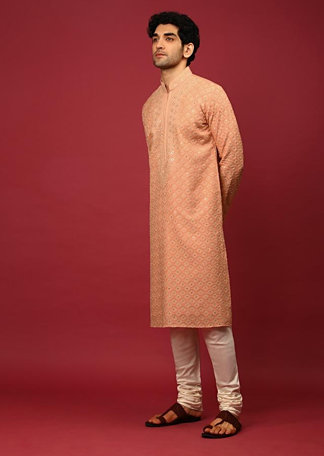 Pastel Peach Kurta Set In Raw Silk Heavily Embroidered With Resham And Mirror Embroidered Geometric Jaal Online - Kalki Fashion