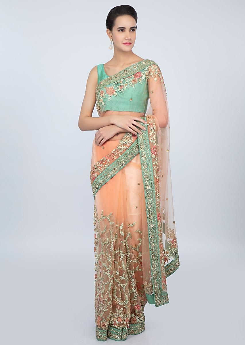 Pastel Peach Saree In Sheer Net With Heavy Floral Jaal Embroidery Online - Kalki Fashion