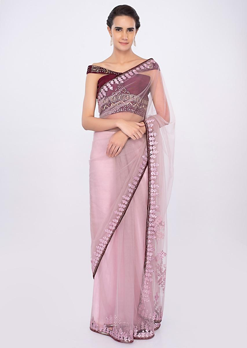 6364fbc39270a Pastel pink draped net saree with plum raw silk off shoulder blouse only on  kalki