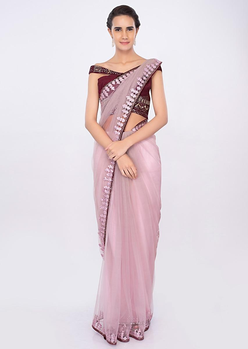 54331bd535a6a4 Pastel pink draped net saree with plum raw silk off shoulder blouse only on  kalki