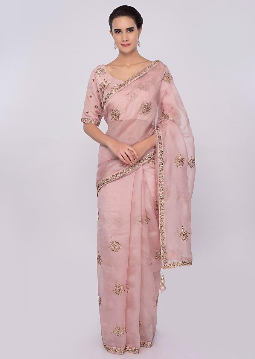 45e71a00a0c00 Pastel pink organza saree with zari embroidered butti and border only on  Kalki
