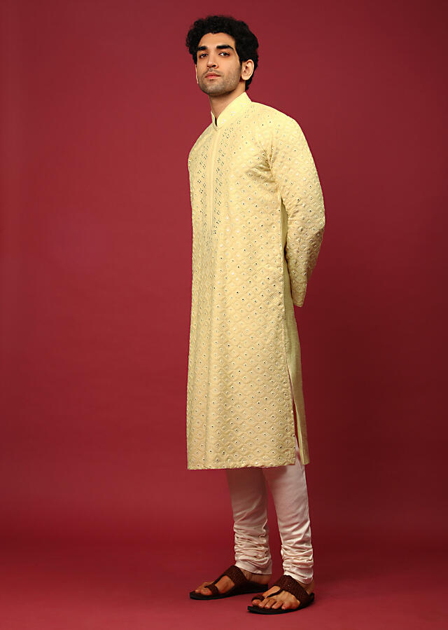 Pastel Yellow Kurta Set In Raw Silk Heavily Embroidered With Resham And Mirror Embroidered Geometric Jaal Online - Kalki Fashion
