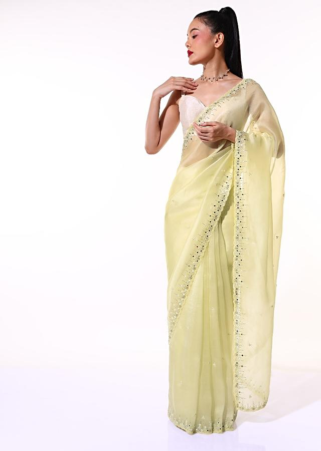 Pastel Yellow Saree In Organza With Mirror Embroidered Scallop Border Along With Cut Dana Accents Online - Kalki Fashion